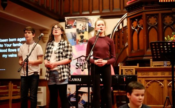 Young people on the stage at Martin's Memorial Church Stornoway