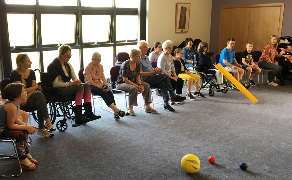 People taking part in a Boccia session
