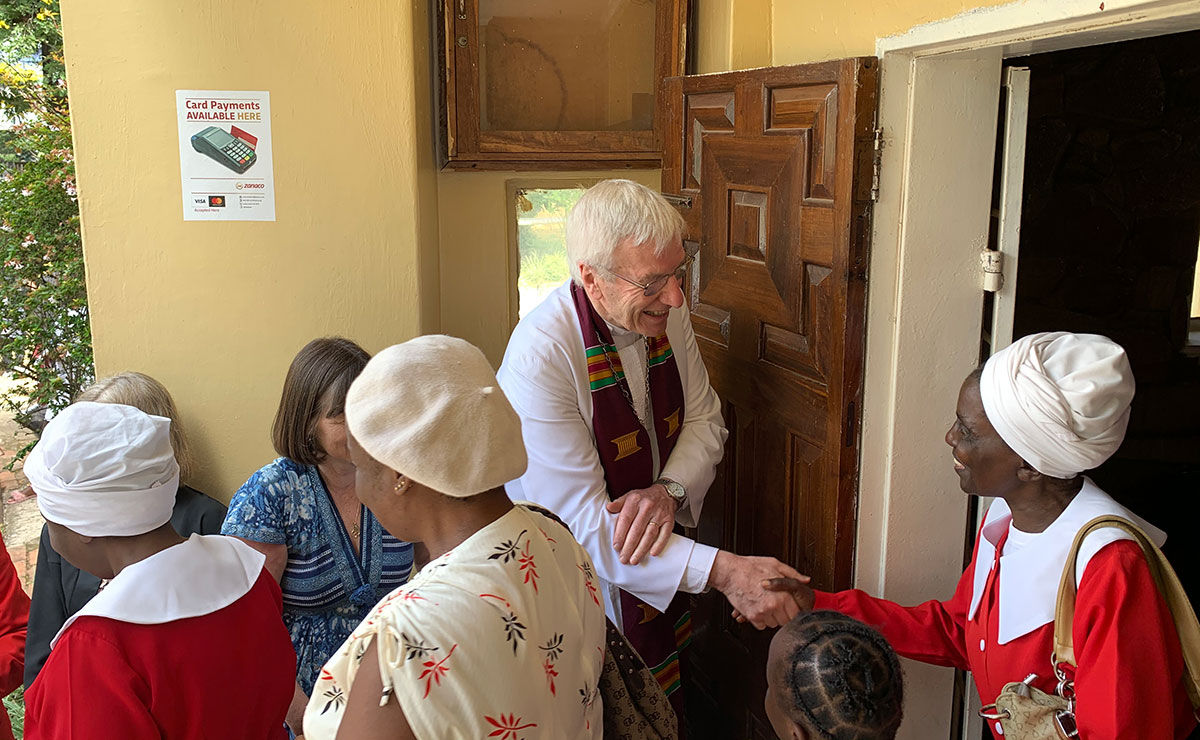Rt Rev Colin Sinclair meets with locals in Zambia during a church service