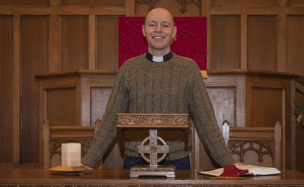 Rev Scott Burton at the altar of his church