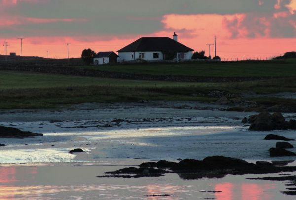 The manse of Tiree Parish Church at sunset