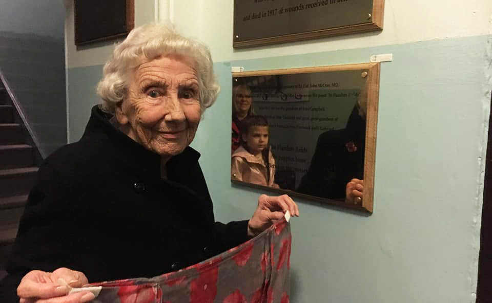 Ina McHattie, whose two uncles were killed in WWI, unveils the plaque dedicated to John McCrae
