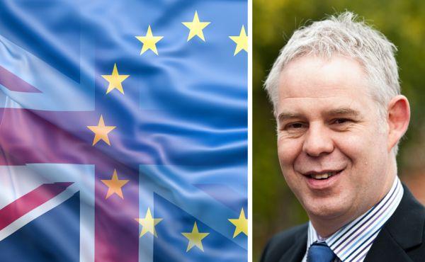 Martin Johnstone, a UK flag and an EU flag
