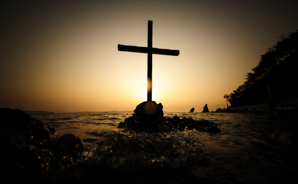 Cross on a rock in the sea