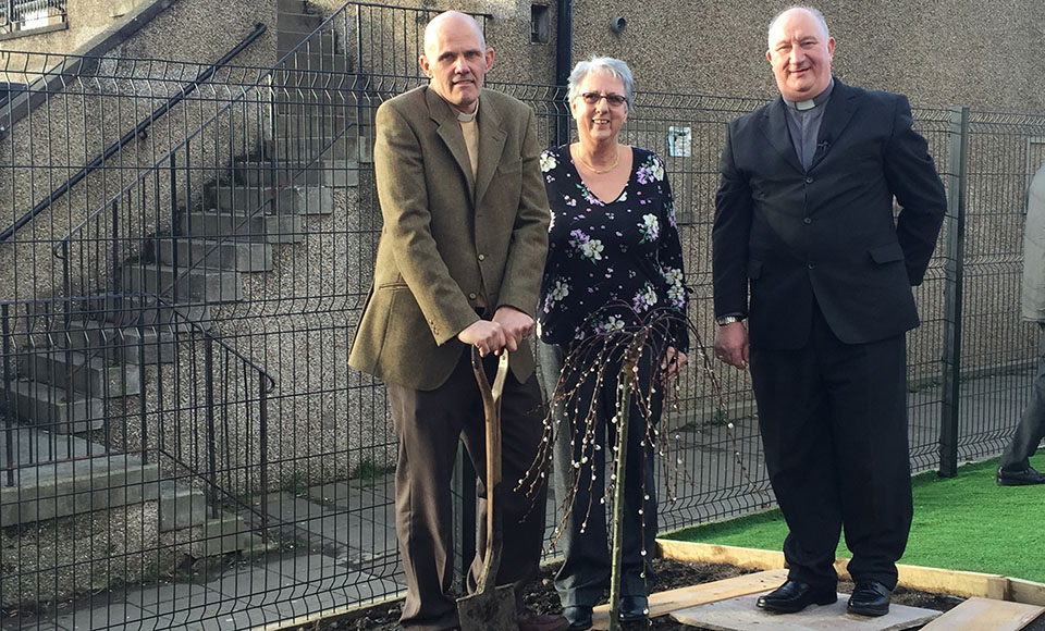 Rev Sean Swindells, Session Clerk Mabel Currie and Rev Malcolm Currie planting a commemorative tree