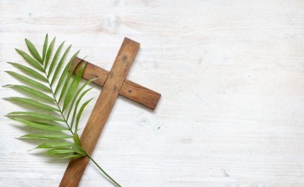 A Cross and a palm leaf