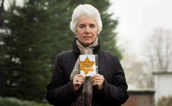 Eva Clarke holding a yellow star of David