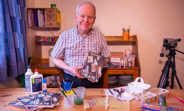 Rob Rawson holding his new book, Go Create