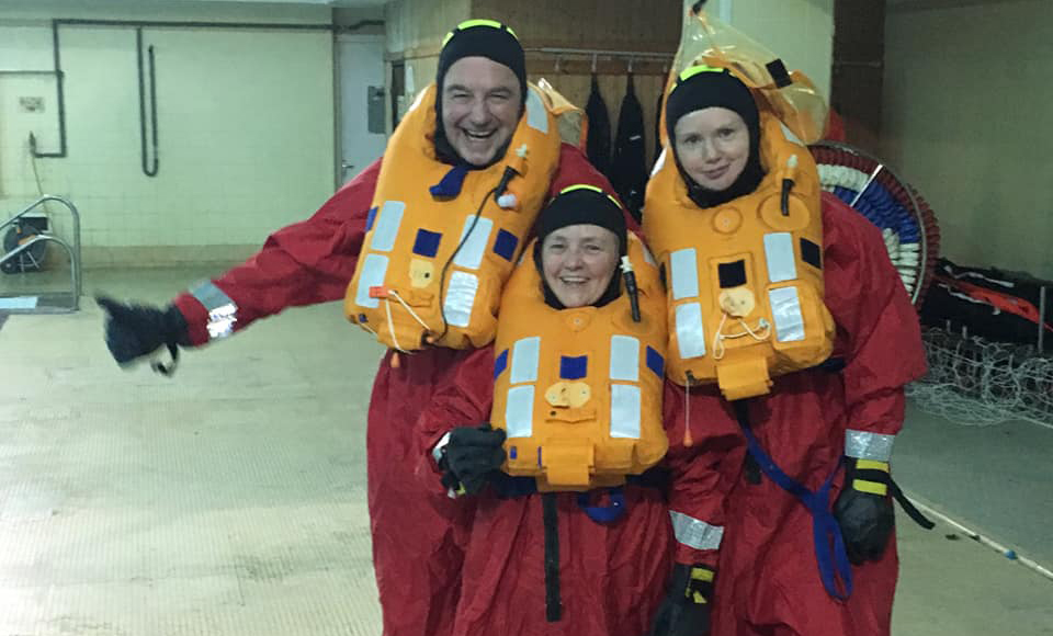 Rev Prof Scott Shackleton, Rt Rev Susan Brown and Rev Dr Marjory MacLean during the lifeboat drill at MOD Caledonia