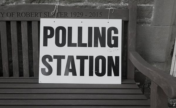 Polling Station sign on a wooden bench