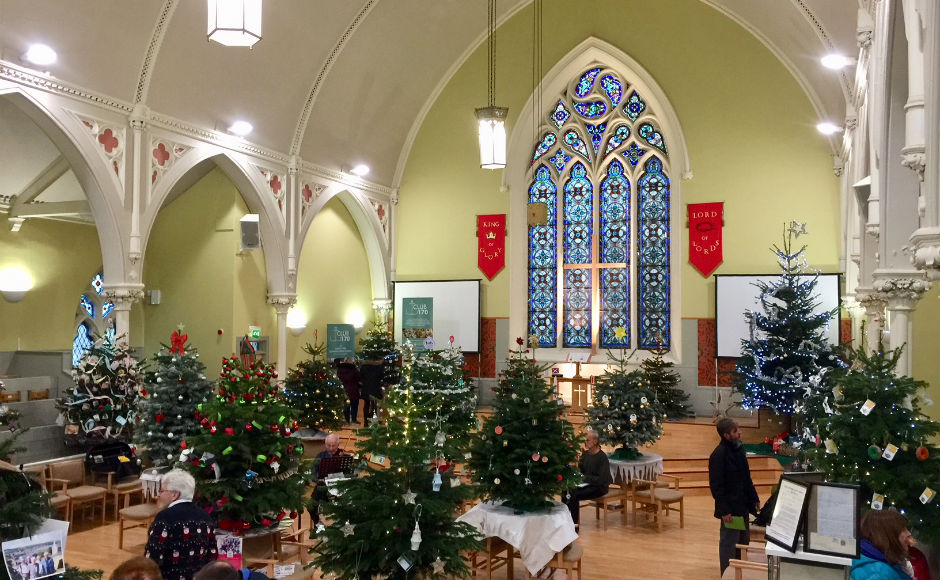 30 decorated Christmas trees in the church