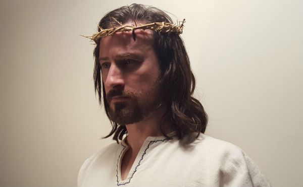 Actor Nicholas Elliott in the role of Jesus wearing a crown of thorns