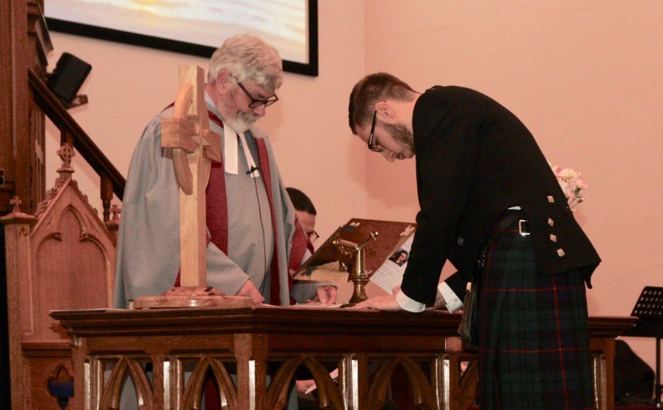 Rev Andrew Morrison signing the call