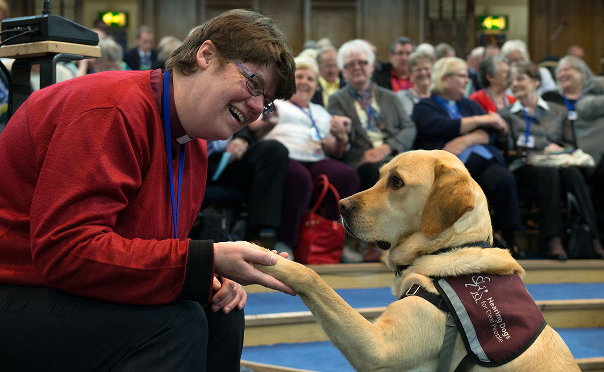 Rev Mary Whittaker with her constant companion – hearing dog Scott