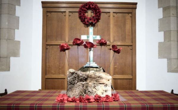 London in 2014. The tablecloth is of Passchendaele tartan and the colours represent the blood spilled in Flanders Fields; the poppies that grew after; the mud of the trenches; the colours of mourning; and hope for the future.
