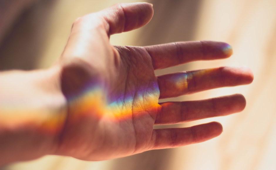 Hand with rainbow by Valeria Boltneva