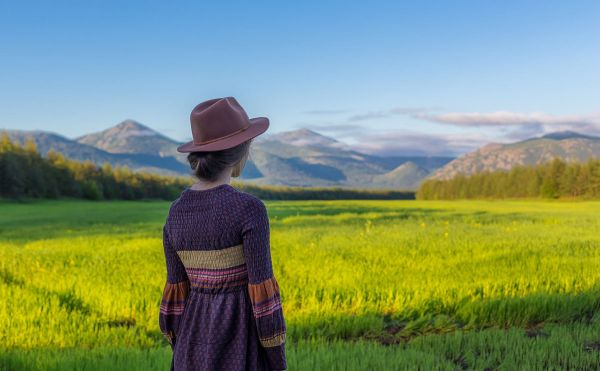 Woman looking over a field