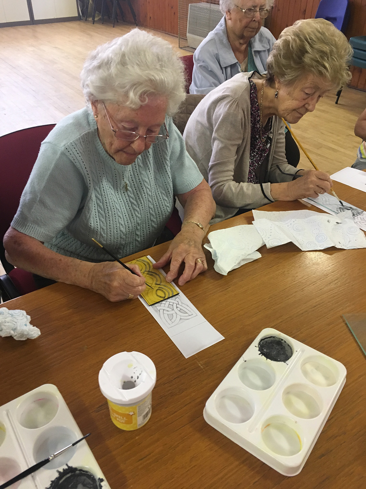 Two members of the senior adult group trying glass painting