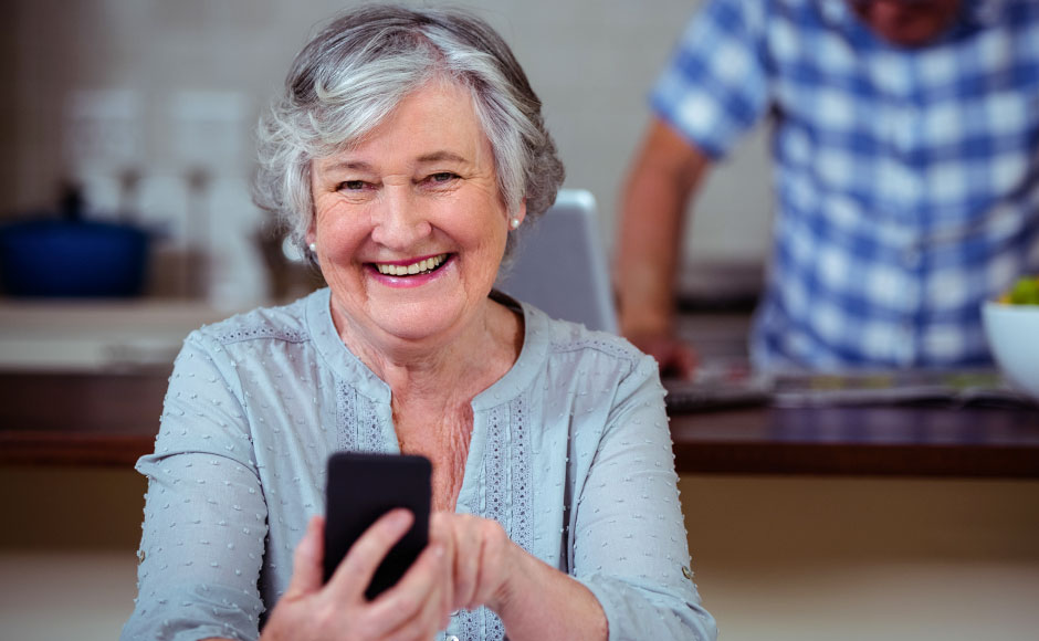 Elderly lady holding a mobile phone