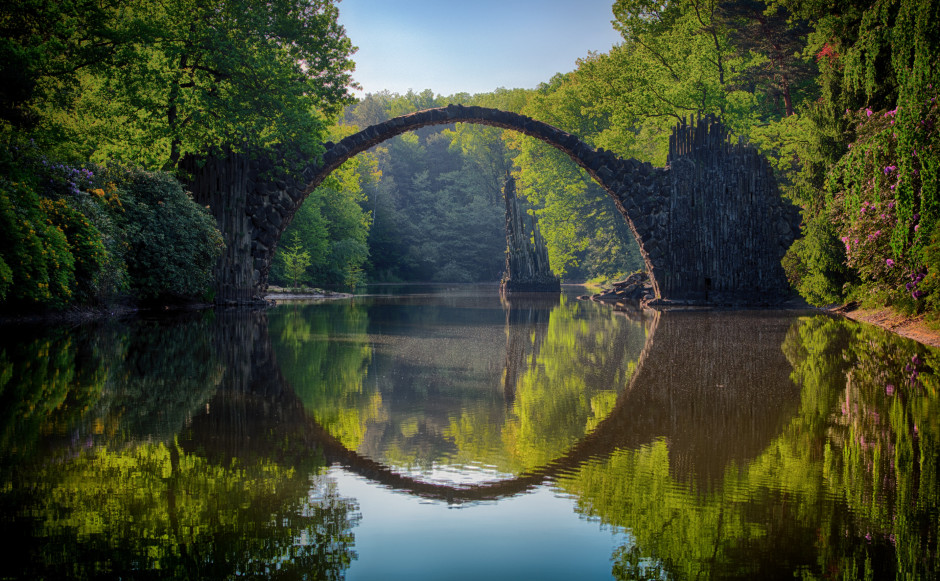 Reflection of bridge in pool