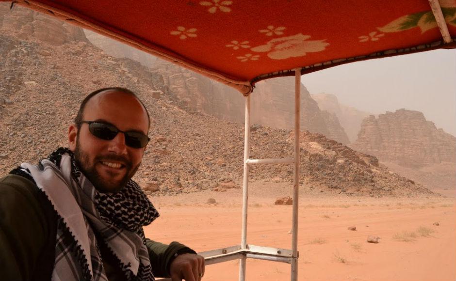 Mark Calder on a truck in the desert