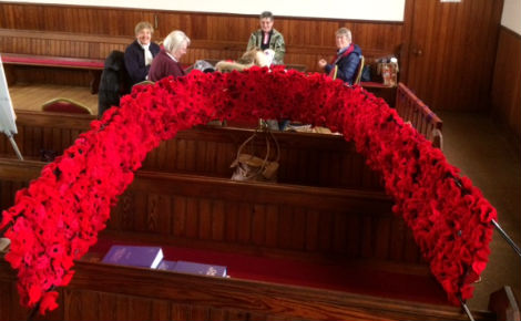 Knitted poppy display made by the congregation