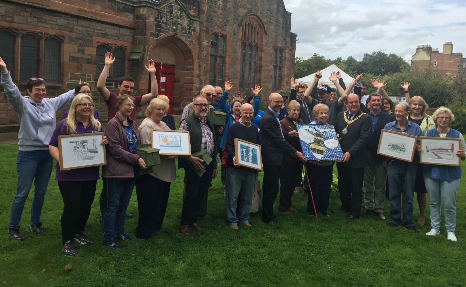 Group photo of people involved with the canal shed project