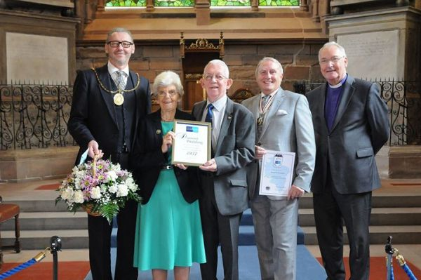 The couple in the church with the Provost of South Lanarkshire