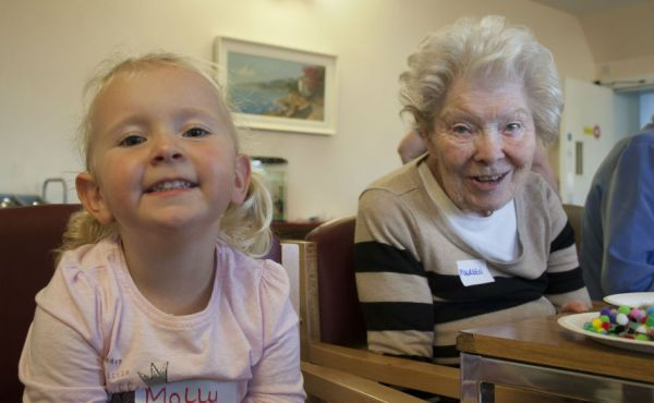 A young girl and a care home resident involved in the project