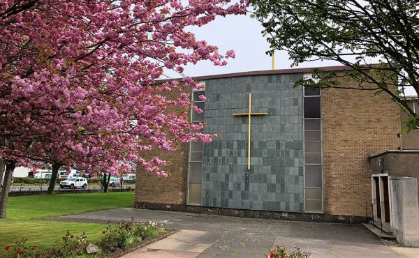 The St Nicholas Church, Sighthill, church building with cherry blossom infront