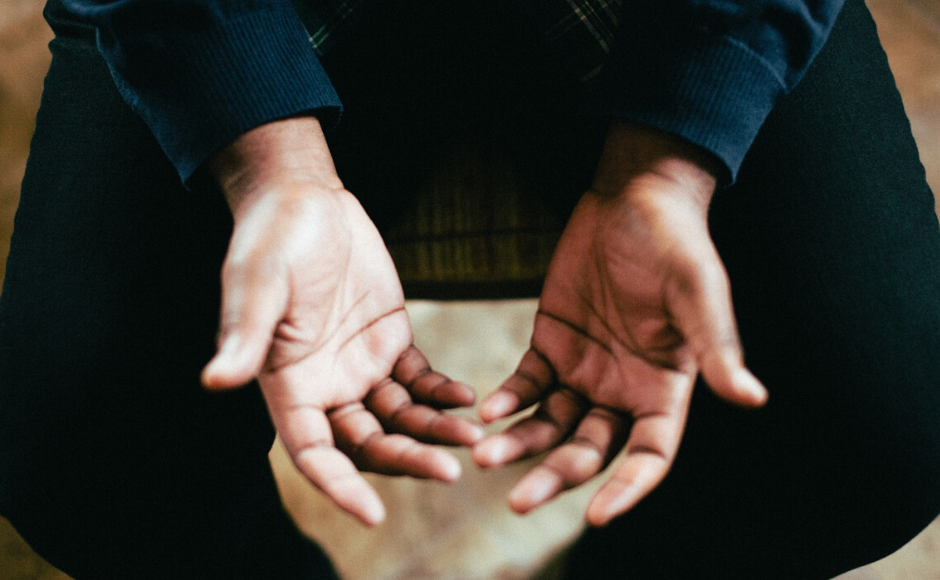 Man's hands praying