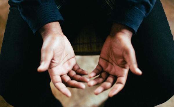Man's hands praying