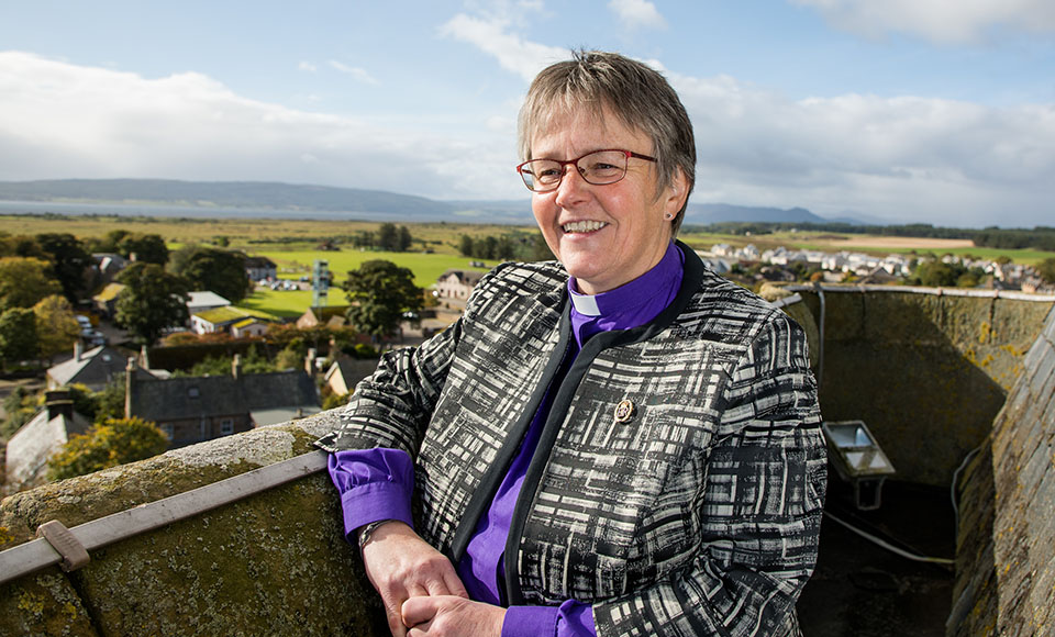 Susan Brown standing on the roof of Dornoch Cathedral