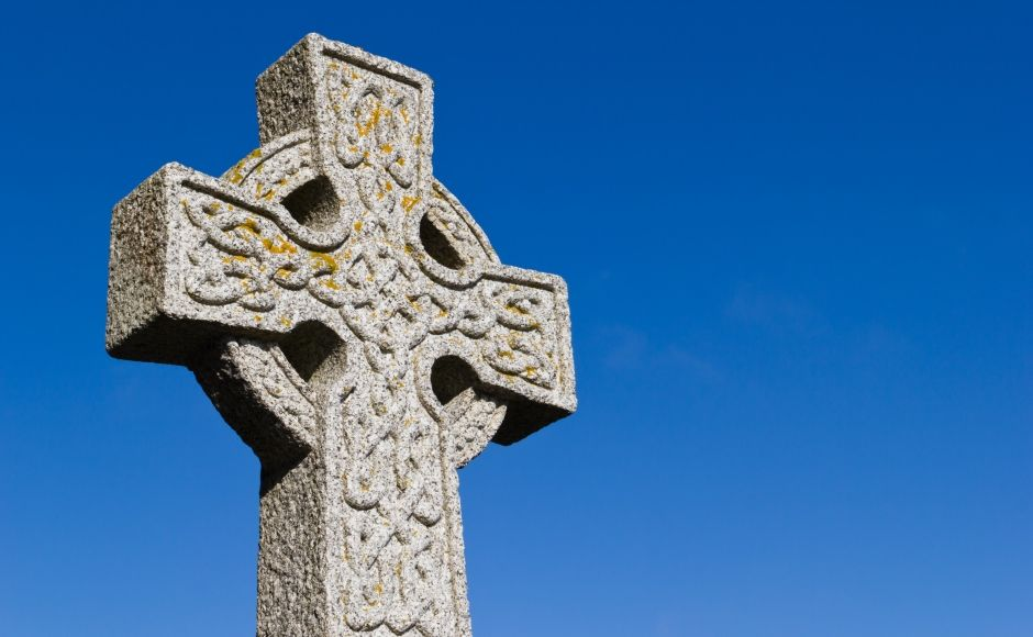 Celtic cross with a blue background