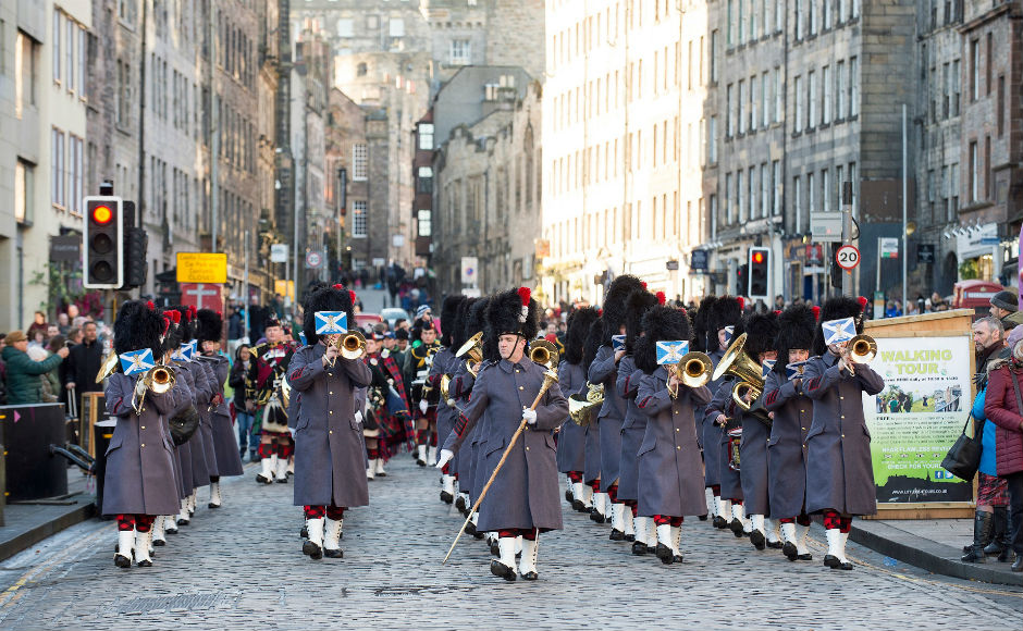 The Band of the Royal Regiment of Scotland marching to West Parliament Square