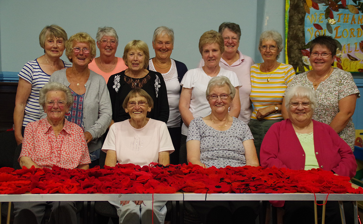 Church members from Uphall South Parish Church in West Lothian working on their knitted and crocheted poppy display