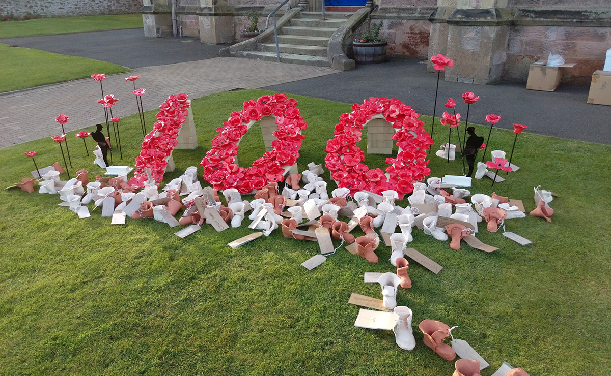 Eyemouth Parish Church's poppy display with ceramic soldier boots
