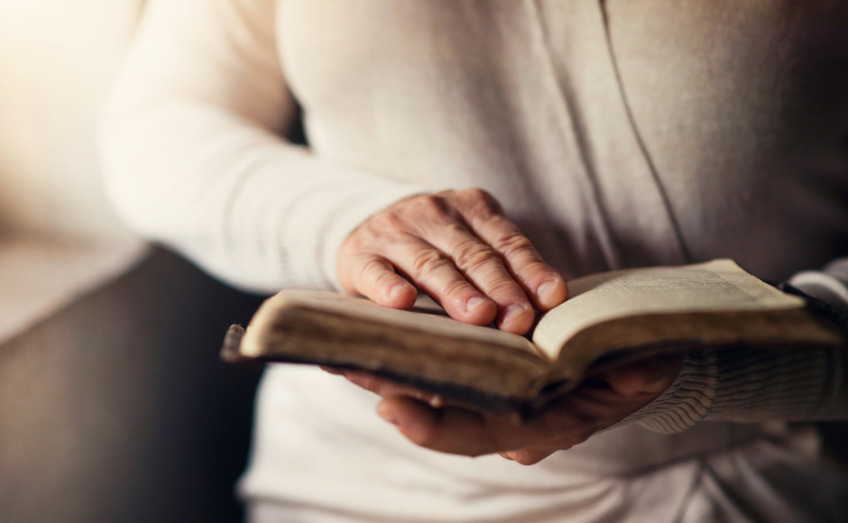 Woman's hands holding a Bible