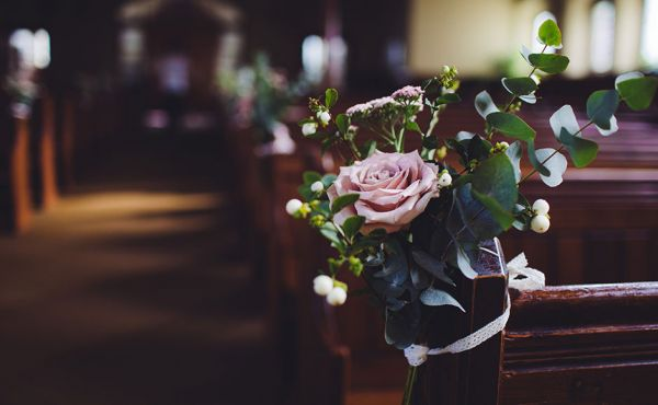 Flowers decorating a pew