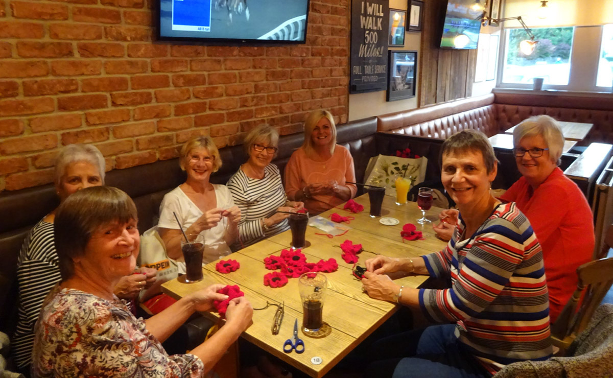 The Crochet Friends group at one of their regular meet-ups preparing for their upcoming poppy display